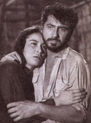 Daniel Gélin hält Anne Méchard in seinen Armen