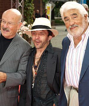 Volker Schlöndorff, David Bennent und Mario Adorf auf dem roten Teppich