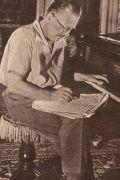 Grock beim Klavier